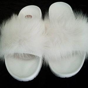New white Ugg furry slip-on sandals